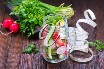 fresh vegetable salad in glass and on a table