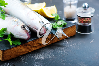raw fish with aroma spice on a table