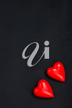 red hearts on the black table
