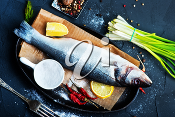 raw fish with spice and fresh salad