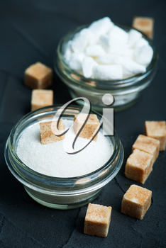 sugar in bowl and on a table