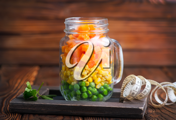 mix vegetables in glass bank and on a table
