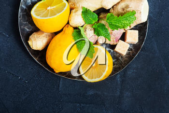 ginger with lemon and mint on a table