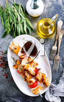 chicken kebab with vegetables on the plate