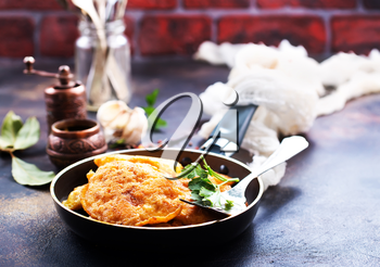 chicken cutlets in pan, cutlets with fresh greens and spice