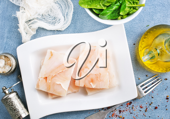 raw fish fillet with salt and spice, white fish