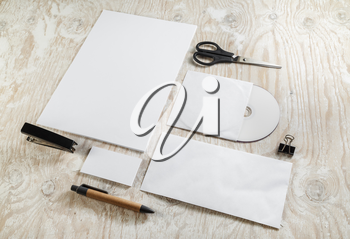 Blank stationery and corporate identity template on light wooden background. Mock-up for design presentations and portfolios.