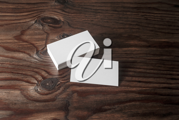Photo of blank business cards on brown wooden background. Template for branding identyty.