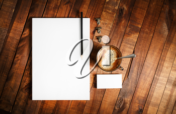 Photo of blank stationery on vintage wooden table background. Responsive design mock up. Template for your design.