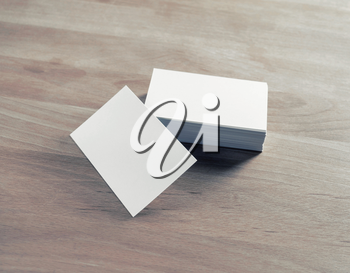 Blank business cards on wooden background. Template for branding identity.