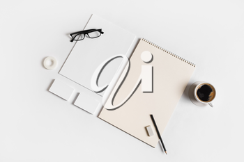 Photo of blank stationery set on white paper background. Corporate identity mock up for placing your design. Top view. Flat lay.