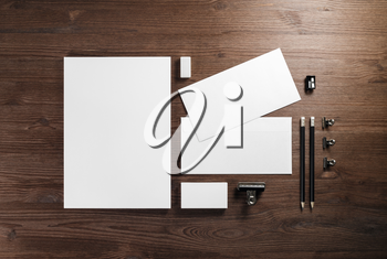Blank corporate stationery template on wooden background. Responsive design mockup. Flat lay.