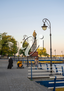 Kherson, Ukraine - 04.27.2019. Monument to the first shipbuilders in Kherson in the spring evening