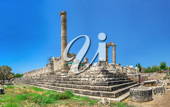 Didyma, Turkey – 2019-07-20. The southern flank of the temple of Apollo with the stadium at Didyma, Turkey, on a sunny summer day