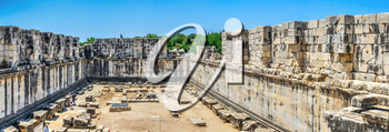 Didyma, Turkey – 2019-07-20.  Ruins of the interior of the temple of Apollo at Didyma. Panoramic view on a sunny summer day