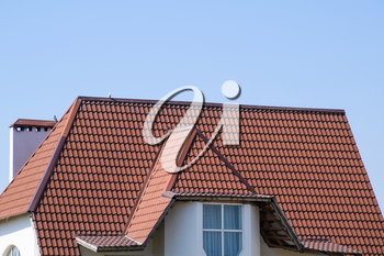 The roof of corrugated sheet. Roofing of metal profile wavy shape.