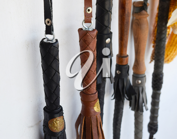 Cossack whip hanging on the wall. Whips leather.