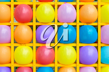 Inflatable balls in square shelves. Multicolored balls background of balls.
