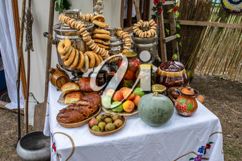 A table in a samovar and baking, this year's canned food.