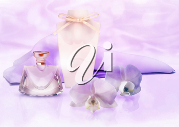 perfume bottle, ribbon and lilac silk scarf with Orchid flowers
