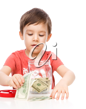 Cute boy with dollars, isolated over white