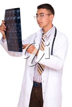 Young male doctor looking at tomography brain, isolated over white
