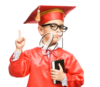 Cute boy is holding book - education concept, isolated over white