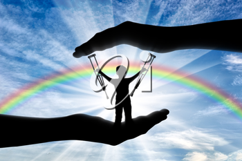 Disabled child standing with crutches in hand on background rainbow day. Concept children with disabilities