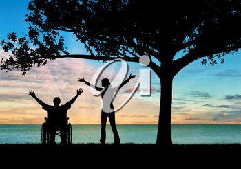 Concept of disability and disease. Silhouette happy disabled and guardian under a tree at sunset