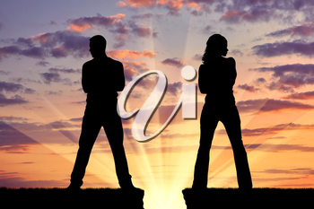 Concept of betrayal and treason. Silhouette of man and woman in a quarrel at sunset