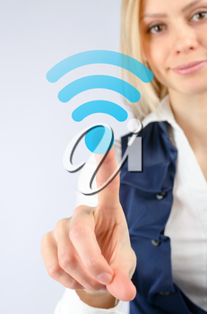 Concept of wireless Internet Wi fi. Business woman clicks on the icon Wi fi
