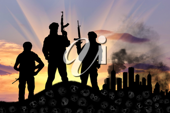 Concept of a terrorist attack. Silhouette of terrorists with a rifle standing on a pile of skulls on the background of the city in smoke