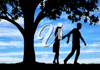 The concept of divorce and parting of a married couple. Silhouette of a man throwing a woman near a tree