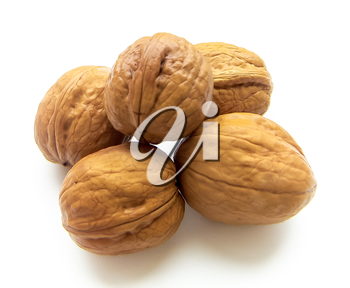 Five walnuts isolated on a white background.