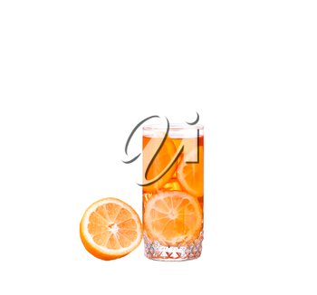 Amber cocktail in a glass isolated on a white background