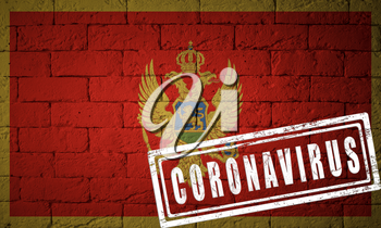 Flag of the Montenegro with original proportions. stamped of Coronavirus. brick wall texture. Corona virus concept. On the verge of a COVID-19 or 2019-nCoV Pandemic.