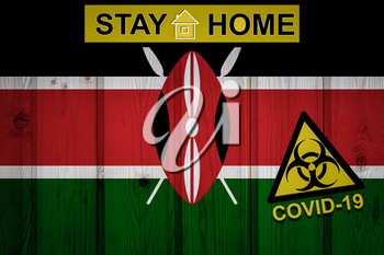 Flag of the Kenya in original proportions. Quarantine and isolation - Stay at home. flag with biohazard symbol and inscription COVID-19.
