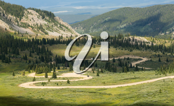 Series of bends on unfinished or dirt road climbing to top of Cottonwood Pass in Colorado