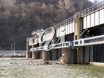 Lock or dam sluice gates on River Monongahela in Morgantown West Virginia with collected trash