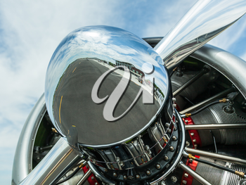 AT-6 Texan, known as the Harvard training plane engine with close up of reflection of runway and airfield in the nose of the propeller