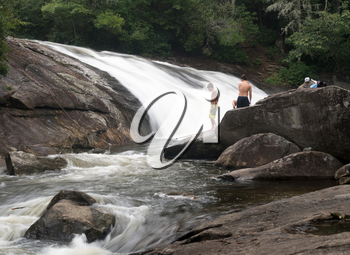CASHIERS, NORTH CAROLINA - AUGUST 21, 2016: Three boys planning to swim in Turtleback Falls in Gorges State Park near Cashiers