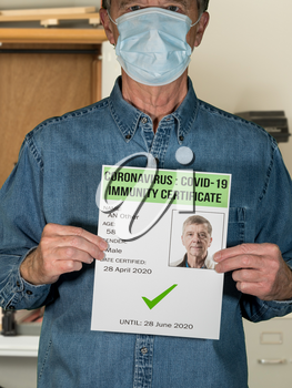 Male blue collar worker concept of immunity testing and certification to allow people to go back to work after negative test