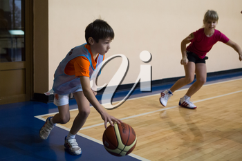 Russia, Volgodonsk - June 02, 2015: Children are trained to play basketball