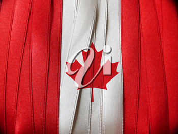 Canada flag or banner made with red and white ribbons