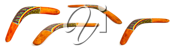 several positions wooden souvenir boomerang decorated with national ornament on a white background