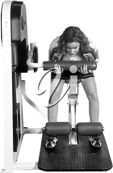Royalty Free Photo of a Woman on a Weight Lifting Machine