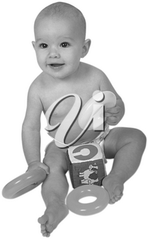 Royalty Free Black and White Photo of an Infant Child Sitting, Playing with Toys