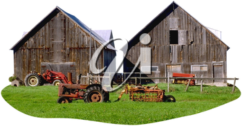 Royalty Free Photo of Two barns and a Tractor