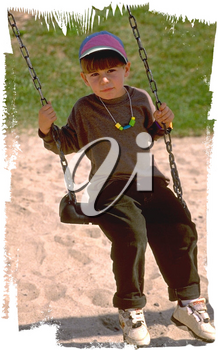 Royalty Free Photo of a Young Boy on a Swing