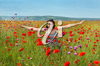 Woman in a field of blooming poppy flowers